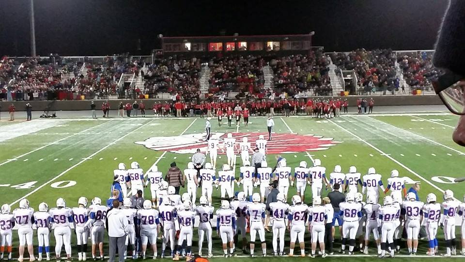 Sioux Center Warriors walk hand in hand for the coin flip against Spirit Lake. Photo Credits: Brooke Byker