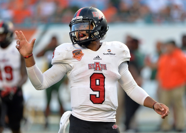 Sep 13, 2014; Miami Gardens, FL, USA; Arkansas State Red Wolves quarterback Fredi Knighten (9) reacts against the Miami Hurricanes during the second half at Sun Life Stadium. Miami won 41-20. Mandatory Credit: Steve Mitchell-USA TODAY Sports