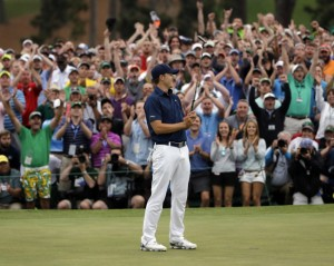 Jordan Spieth celebrates after making his final putt to win The Masters. Spieth became the 2nd youngest man to win The Masters, only Tiger Woods was younger.