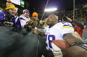 Jan 3, 2016; Green Bay, WI, USA; Minnesota Vikings running back Adrian Peterson (28) celebrates with fans following during the game against the Green Bay Packers at Lambeau Field. Minnesota won 20-13. Mandatory Credit: Jeff Hanisch-USA TODAY Sports