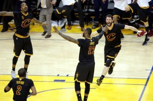 Jun 19, 2016; Oakland, CA, USA; Cleveland Cavaliers forward LeBron James (23) celebrates with Cleveland Cavaliers guard J.R. Smith (5) and Cleveland Cavaliers forward Kevin Love (0) after beating the Golden State Warriors in game seven of the NBA Finals at Oracle Arena. Mandatory Credit: Kelley L Cox-USA TODAY Sports